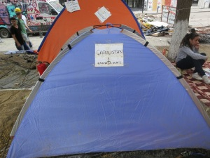 A protester's tent's address is No. 1 Capulistan.