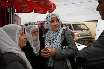 Turkish Mayor Berivan Kilic speaks with residents at a market in her town Kocakoy. Photo by Tara Todras-Whitehill