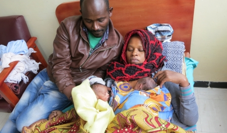 "At a hospital in Ethiopia's capital, Wandamu and his wife Lakish have been in practicing kangaroo care for nearly three weeks. Their heavier, healthier twin, can now sleep on his own and is breast feeding healthily. The smaller twin is still in the ""kangaroo"" position on his mom's chest."