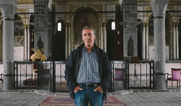 Armen Demircian says he's found a home at this recently restored Armenian Church in Diyarbakir, Turkey — though he's not a Christian. Credit: Bradley Secker