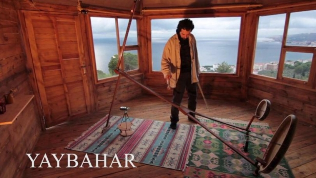 Görkem Şen plays the Yaybahar with the Marmara Sea in the background. He hopes his instrument will soon be as common as a violin or cello. Credit: Courtesy of Görkem Şen